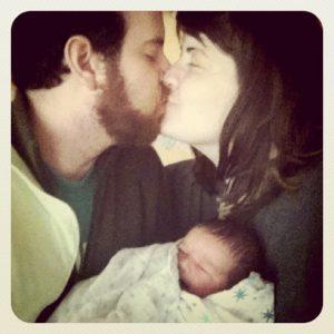 kiss newborn family