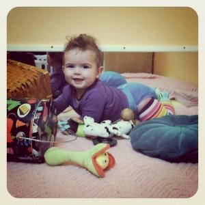 phoebe crawling through her toys